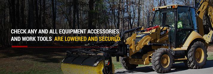 Site prep sweeper attachment cleans of asphalt driveway.
